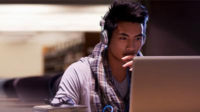 Man studying at laptop