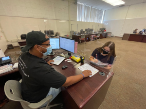 Student receives help at Student Services Center desk