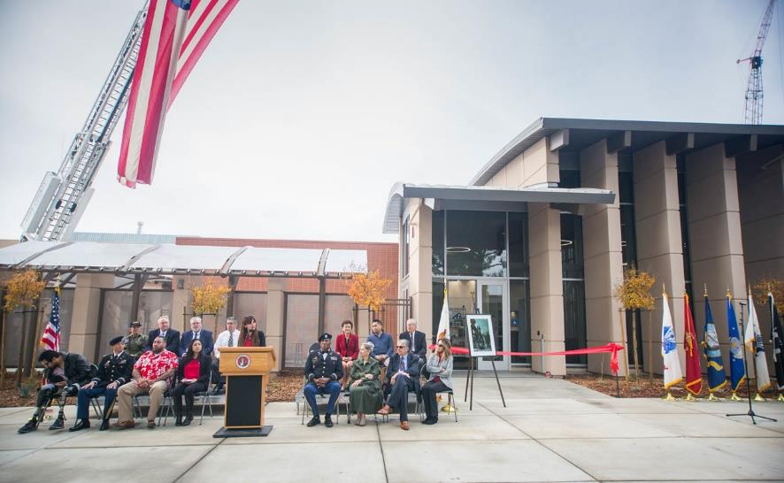 Dignitaries speak at the VRC Ribbon Cutting event