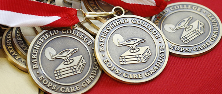 Three medals laying on red background