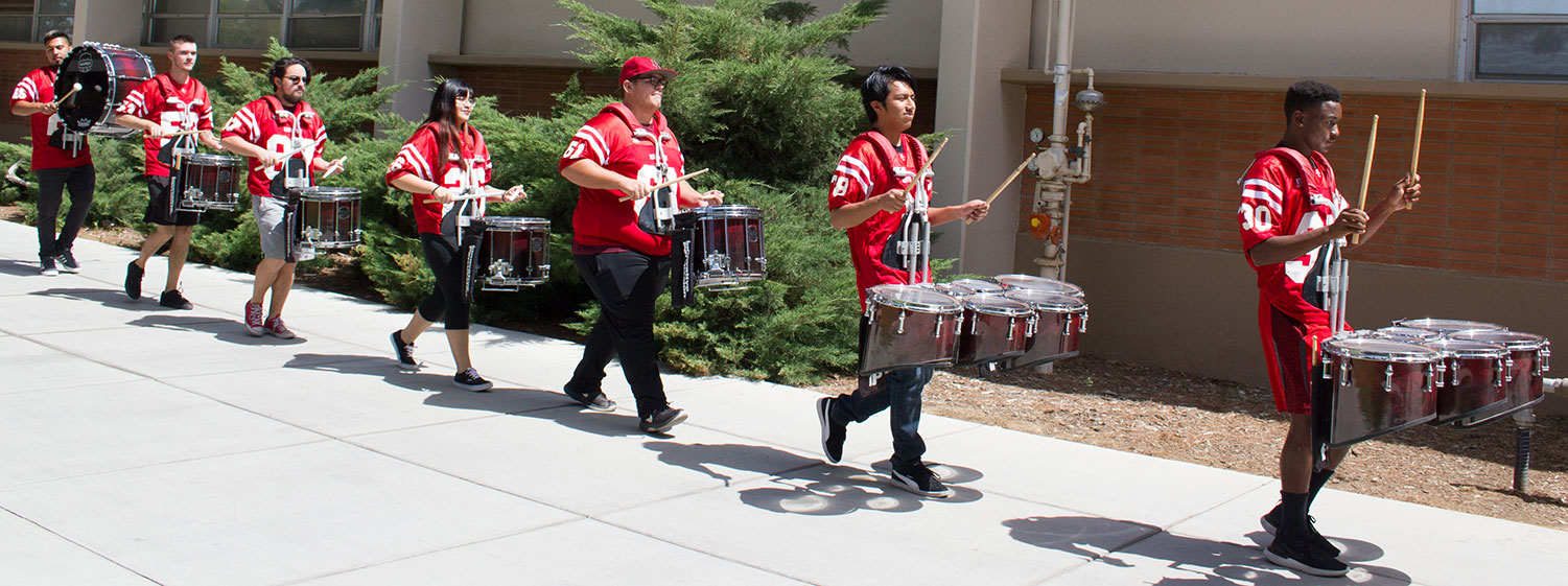 BC drumline marching while playing.