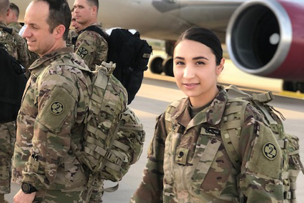 Female soldier waiting to board plane