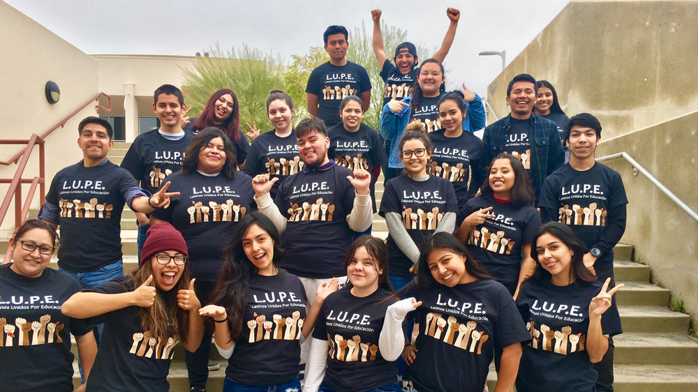 Group of LUPE students standing on steps