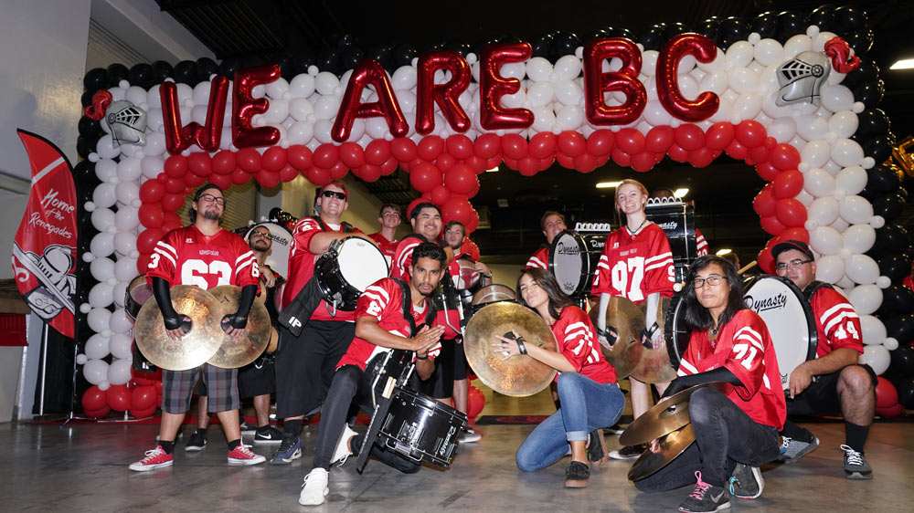 drumline on stage with We Are BC balloons
