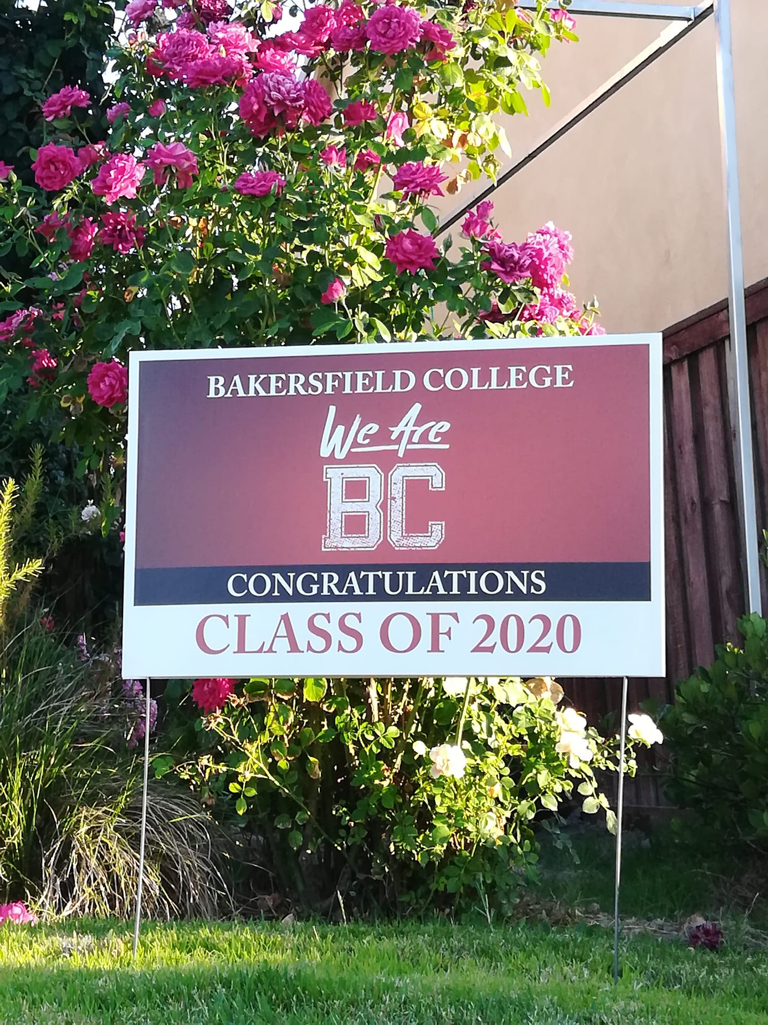 We are BC; Congratulations Class of 2020 sign in front of beautiful flowers.