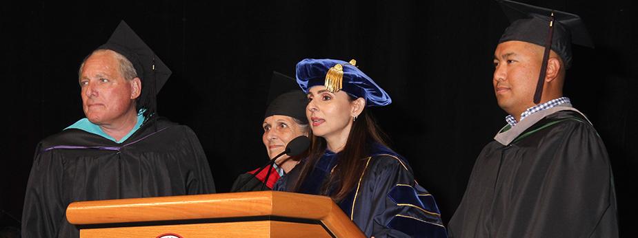 President Sonya Christian speaking at commencement.