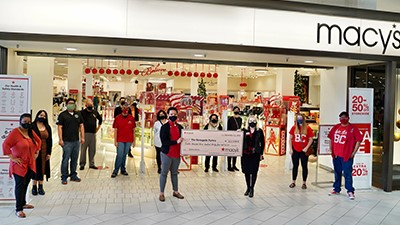 Macys staff and BC students pose outside the Macys store at the mall