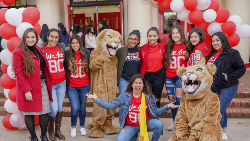 Group of BC staff with McFarland High School mascots