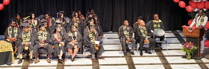 Pre-Commencement graduates listen to the keynote speaker