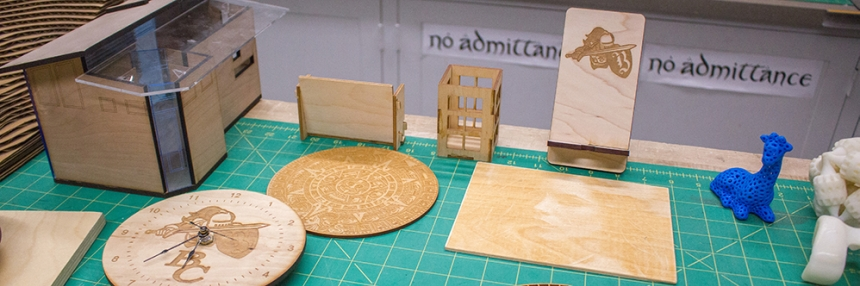 Multiple wood fabrications and 3D printer models made in the creative design center.