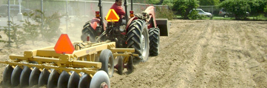 A tractor plows a field at Bakersfield College