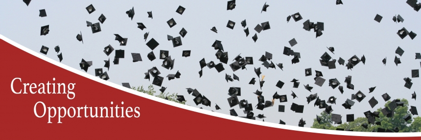 Graduation Caps flying in the air.