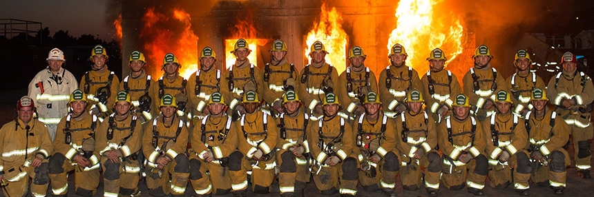 People in firefighter uniforms posing