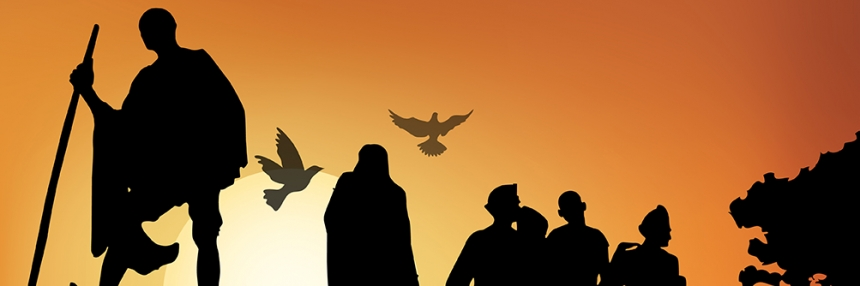 Silhouette of Gandhi leading people against a rising sun with doves.