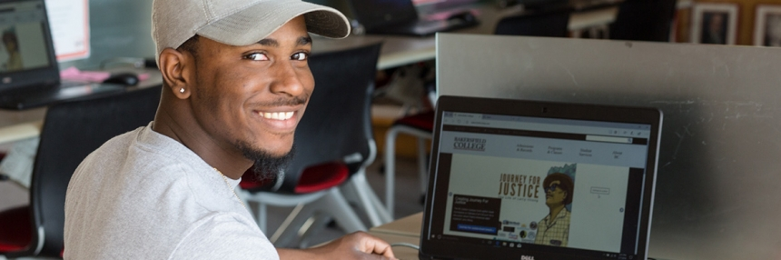 Student at computer.