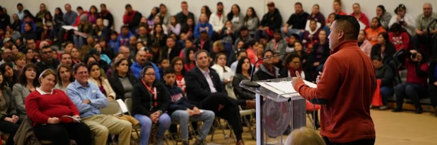Man standing at podium speaking to audience