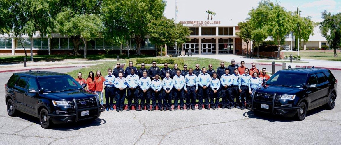 Public Safety staff poses in front of the Administration Building