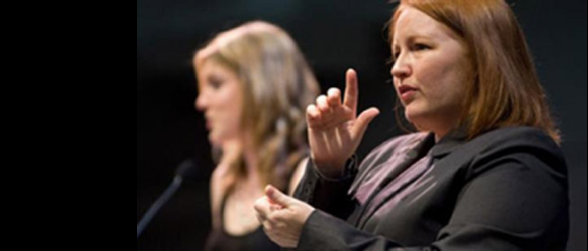 ASL Interpreter signing during a speech.