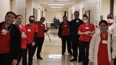 BC's Nursing Students wearing masks in a hospital hallway