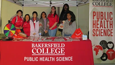 Students gather behind a BC Public Health Booth