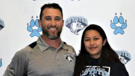 CCCC Athletic Director John McHenry congratulates Coyote softball player Annika Ramon on signing to play for the William Woods University Owls in the spring.