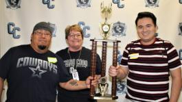 President Jill Board (center) congratulates gaming tournament winners of the sponsorship competition representing President's Circle Member Ridgecrest Regional Hospital Eddie Conde (left) and Armando Contreras (right) who fought hard to win the trophy along with some serious bragging rights.