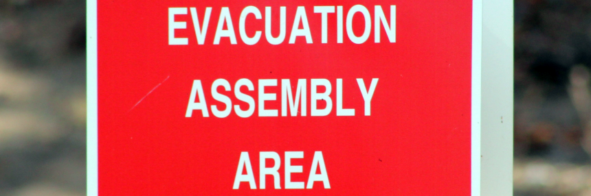 Evacuation Assembly Area (Red Sign)