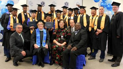 Distinguished guests included: (front seated) Warden George Jaime, Cerro Coso President Jill Board, California Department of Corrections and Rehabilitation(CDCR) Superintendent Shannon Swain, CDCR Director of Rehabilitation Brant Choate, and CDCR Principal Dr. Lincoln Johnson.  (Far right standing) KCCD Chancellor Thomas Burke.