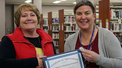 Adjunct Psychology Instructor Christina Christenson-Rockwell receives her longevity pin and certificate from CCCC President Jill Board.