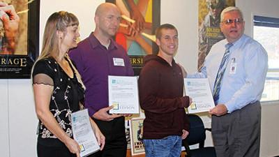 L to r: Tina Kooivu, Kristhomas Snyder, and a high school student, receive SCE STEM scholarships by KRVECF President Tim McGlew.