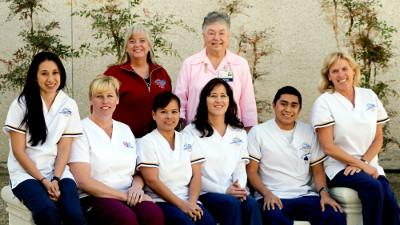 Caption: Front l to r – Lori Bollinger, Kellee Clodt (Career Care Institute), Menchie Schneiter, Chrissie Jensen, Luis Enrique Carrillo, and Barbara Dolan. Back l to r – Annette Hodgins, CCCC Vocational Nursing Faculty Director; and Barbara Martin, Ridgecrest Regional Hospital Pink Ladies Auxiliary.