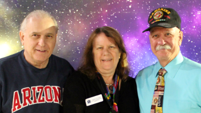 Faculty members Frank Timpone, Karen O'Connor, and Tony Damiano pose for a photo at the star party photobooth.