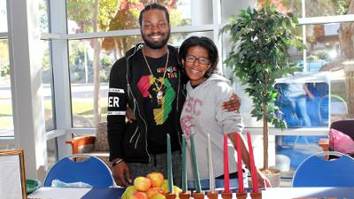 (L to r) Students Teshaun Claiborne and Letia Bogan celebrate the Kwanzaa festival.