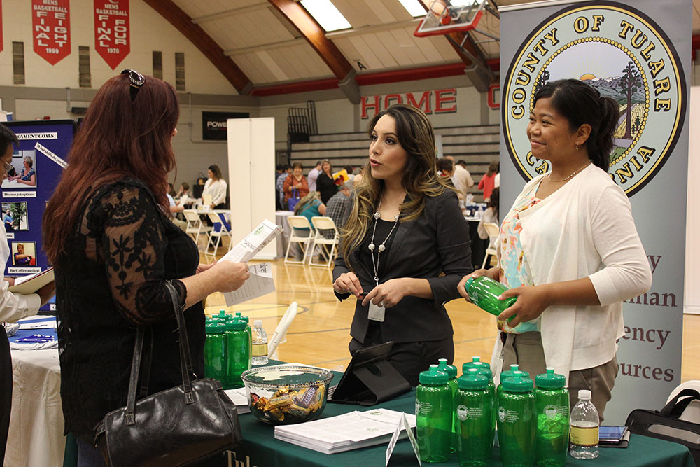 Employers at a job fair in PC gym